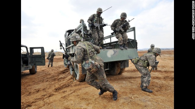 South Korean Army soldiers jump off a military truck during a drill outside a U.S. airbase in Pyeongtaek as part of annual joint exercises with the United States, on March 14.