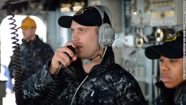 In this Navy handout image taken on March 5, Lt.j.g. Matthew Harmon serves as helm safety officer aboard the guided-missile destroyer USS McCampbell during a replenishment-at-sea, part of Foal Eagle 2013, the joint exercises between the United States and South Korea.