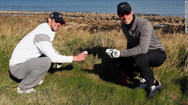 Phelps poses with Paralympic running champion Oscar Pistorius after they both lose their ball during the Alfred Dunhill Links Championship pro-am at Kingsbarns in Scotland in October 2012.