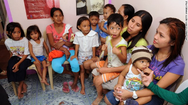 Mothers wait for family planning services at the Likhaan Center for Women's Health in Baseco, a slum in Manila, on January 16.