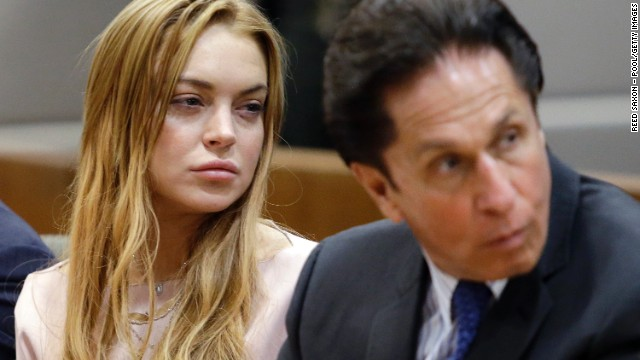 Lindsay Lohan, left, with attorney Mark Heller. Heller is under investigation for suspicion of witness tampering.