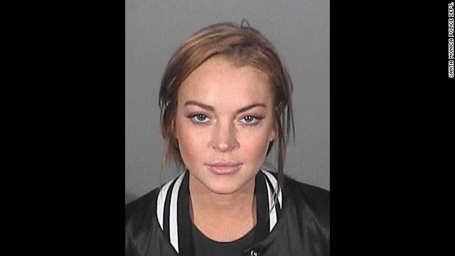 "Lindsay Lohan poses for a mug shot on March 20, after accepting 90 days in a ""locked in"" drug rehab facility for misdemeanor charges. This was not her first brush with the law. The laundry list includes a 2011 arrest for violating her probation for a 2007 drunken driving conviction."