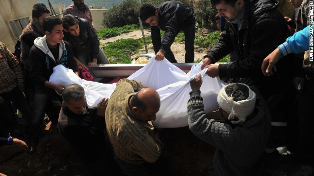 Syrians carry the body of a Syrian army soldier during a funeral ceremony in Idlib province on Tuesday, March 19.