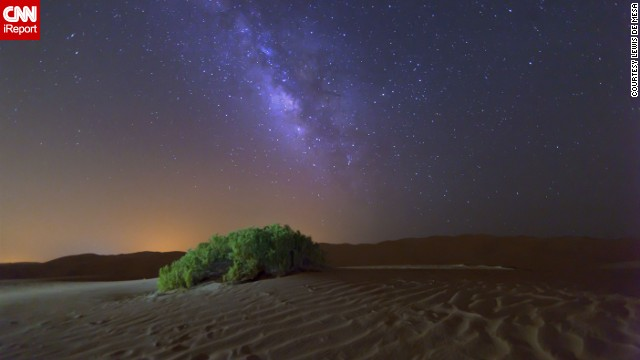 The Milky Way galaxy shines in the sky above the desert outside Abu Dhabi.