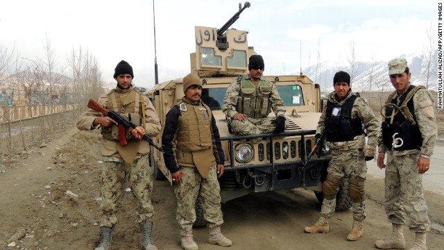 Afghanistan border policemen stand guard near their US-made vehicle in Maidan Shar, capital of Wardak province on March 18, 2013.