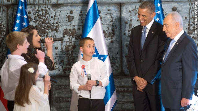 Obama and Peres listen to children sing before meeting on March 20.