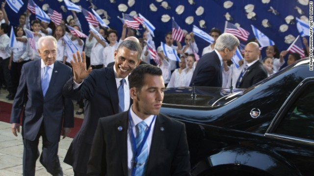Obama and Peres head into the Israeli president's house in Jerusalem on March 20.