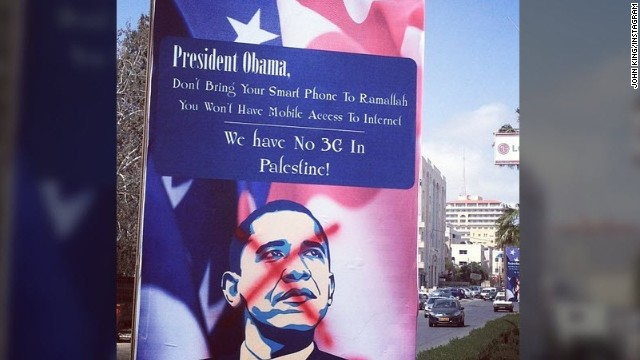 In Ramallah, West Bank, a message to Obama airs grievances regarding limits on cell phone service in the region.
