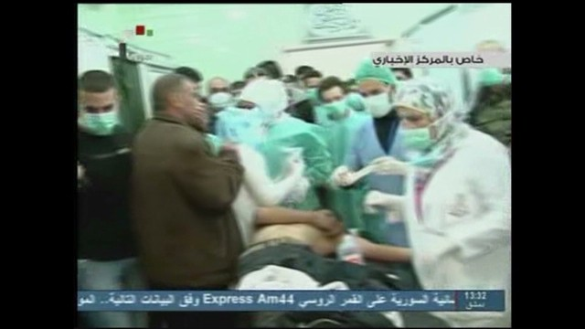 Syrian state TV shows victims of a March 19 attack in which some claim sarin gas was used.