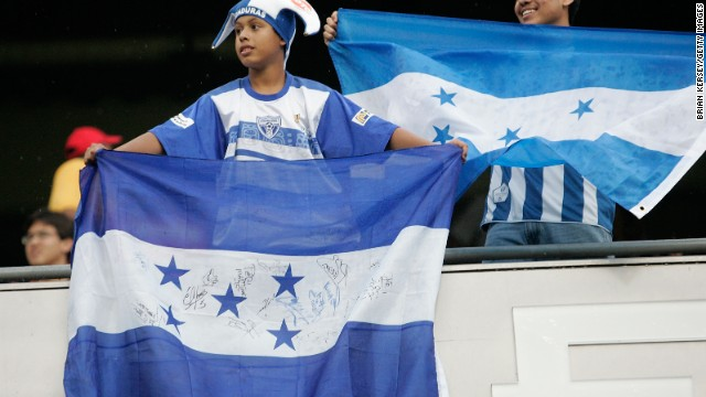 A fan of Honduras holds up a flag in support of their team against the USA during their CONCACAF Cup Semifinal match at Soldier Field on July 23, 2009 in Chicago, Illinois.