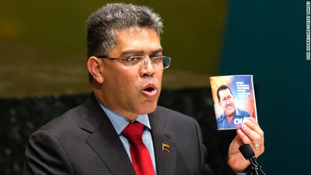Venezuelan foreign minister Elias Jaua holds a photo of Hugo Chavez during a tribute on March 13 at the U.N. in New York.