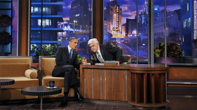 Leno returned in March 2010 and is currently the host. Pictured, Leno chats with President Barack Obama during a taping, October 2012.
