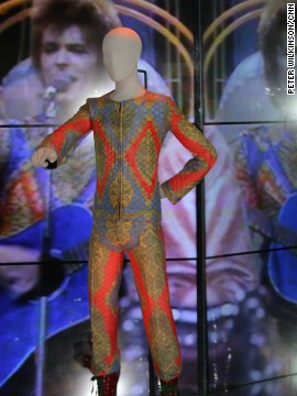 "David Bowie's electric performance of ""Starman"" on the BBC program ""Top of the Pops"" in July 1972 wearing this vivid outfit cemented his status in Britain. DJ Marc Riley said it ""lit the touchpaper for thousands of kids,"" thanked in no small measure by Bowie's homoerotic stage play with guitarist Mick Ronson."