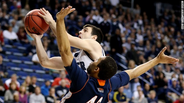 Alex Barlow of the Butler Bulldogs shoots against Cameron Ayers of the Bucknell Bison on March 21 in Lexington, Kentucky.
