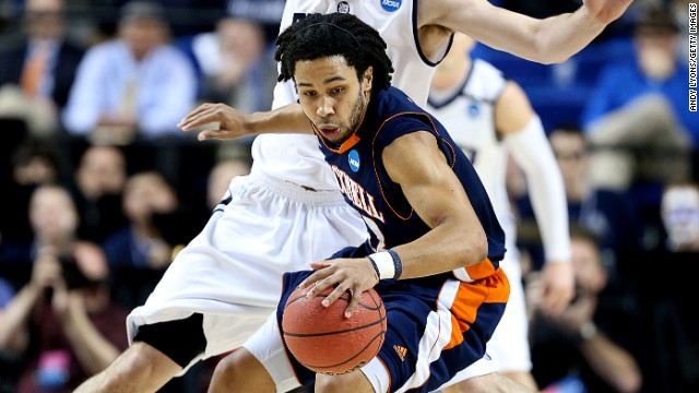 Bucknell's Bryson Johnson drives against Andrew Smith of Butler on March 21.