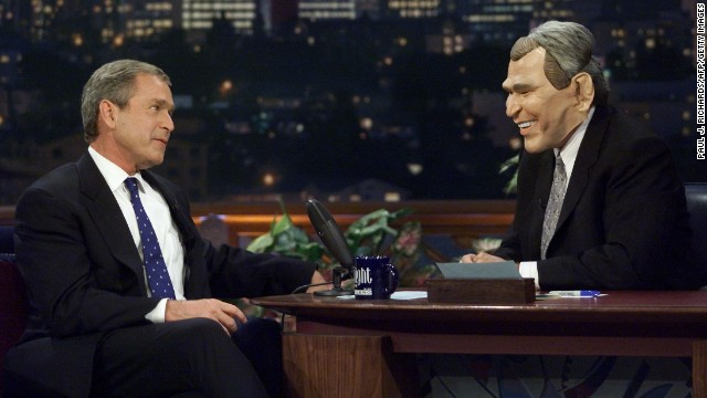 Texas Gov. George W. Bush and Leno in a Bush mask on October 30, 2000.