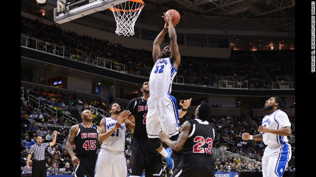 Cory Remekun of St. Louis dunks a rebound on March 21 against New Mexico State.