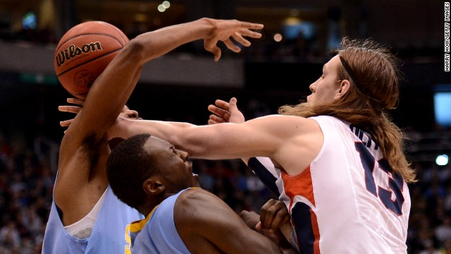 Kelly Olynyk of Gonzaga, right, goes for the ball against Madut Bol and Brandon Moore of Southern University on March 21.