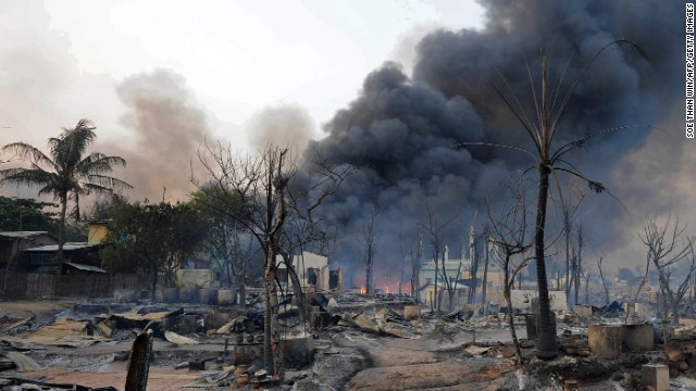 Smoke rises from burning houses around a mosque in riot-hit Meiktila in central Myanmar on Thursday.