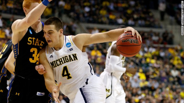 Mitch McGary of Michigan moves the ball against Tony Fiegen of South Dakota State on March 21.