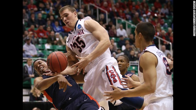 Kaleb Tarczewski of Arizona goes for the ball against Blake Jenkins of Belmont on March 21.