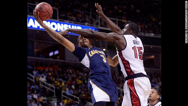 Tyrone Wallace of California drives to the basket against Anthony Bennett of UNLV on March 21.
