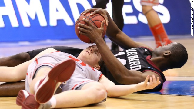 Cameron Bairstow of New Mexico and Steve Moundou-Missi of Harvard battle for a loose ball on March 21.