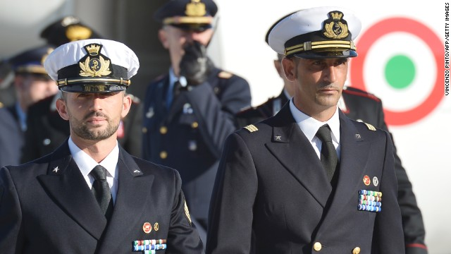 Italian marines Massimiliano Latorre (R) and Salvatore Girone (L) arrive at Ciampino airport near Rome on December 22.