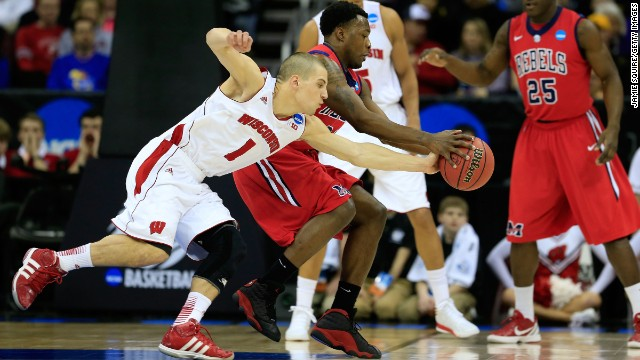 Ben Brust of the Wisconsin Badgers, left, steals the ball from Nick Williams, center, of the Ole Miss Rebels on March 22 in Kansas City, Missouri.