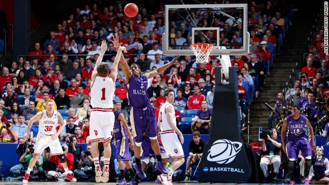 Jordan Hulls of the Indiana Hoosiers, second from left, shoots a three-point basket against Alioune Diouf, third from left, of the James Madison Dukes on March 22.