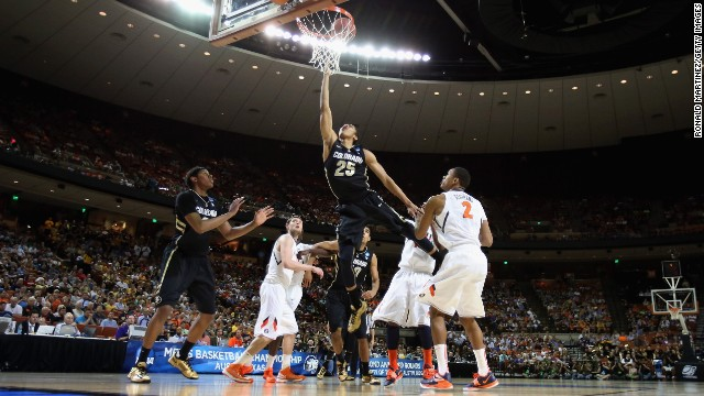 Spencer Dinwiddie of the Colorado Buffaloes goes for a layup on March 22 in Austin, Texas.