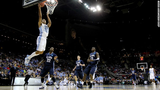 James Michael McAdoo of the North Carolina Tar Heels, left, shoots a layup against JayVaughn Pinkston of the Villanova Wildcats on March 22.
