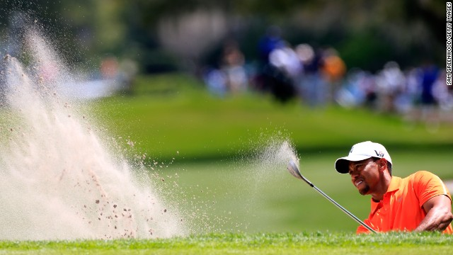 Defending champion Tiger Woods plays a bunker shot during the second round of the Arnold Palmer Invitational on Friday.