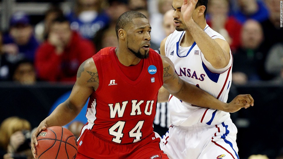 George Fant of the Western Kentucky Hilltoppers, left, drives against Perry Ellis of the Kansas Jayhawks on Friday, March 22, in Kansas City, Missouri. Check back this weekend to follow the action during second round of the 2013 NCAA tournament, and <a href='http://www.cnn.com/2013/03/19/worldsport/gallery/ncaa-tournament-first-round/index.html'>look back at the NCAA First Four</a>.