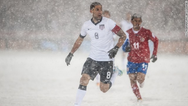 U.S. soccer player Clint Dempsey, No. 8, is surrounded by snow during a FIFA 2014 World Cup Qualifier match between Costa Rica and the United States in Commerce City, Colorado, on Friday, March 22. 