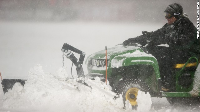 Snow is cleared from the field following the first half of a FIFA 2014 World Cup Qualifier match between Costa Rica and the United States in Commerce City, Colorado, on Friday, March 22. The United States topped Costa Rica, 1-0.