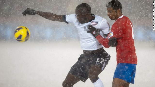 Forward Jozy Altidore of the United States, left, and defender Michael Umana of Costa Rica attempt to gain control of the ball.