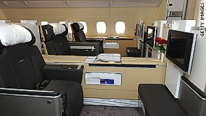 Lufthansa\'s first class: retractable walls between seats can separate passengers.
