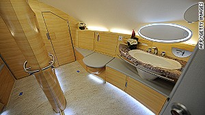 Nope, that\'s not your hotel. It\'s the bathroom available to first-class passengers on Emirates Airlines A380 flights.