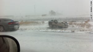 A car lies flipped after an accident on Interstate 25 near Pueblo, Colorado, on Saturday.