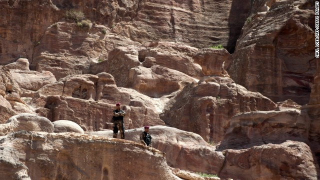 Members of the U.S. Secret Service stand watch in Petra.