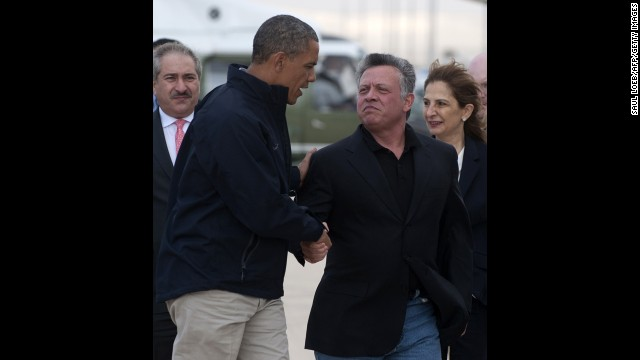 Obama shakes hands with Jordan's King Abdullah II prior to boarding Air Force One to depart from Queen Alia International Airport in Amman, Jordan, on Saturday, March 23.
