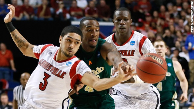 Peyton Siva of Louisville Cardinals, left, steals the ball from Greg Smith of Colorado State on March 23.
