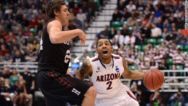 Mark Lyons of Arizona drives on Harvard's Jonah Travis March 23.