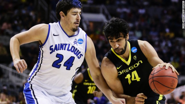 Arsalan Kazemi of the Oregon Ducks, right, drives against Cody Ellis, left, of the Saint Louis Billikens on March 23 in San Jose. Oregon won 74-57.