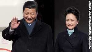 Chinese President Xi Jinping and his wife Peng Liyuan get off the plane at Vnukovo airport outside Moscow on March 22.