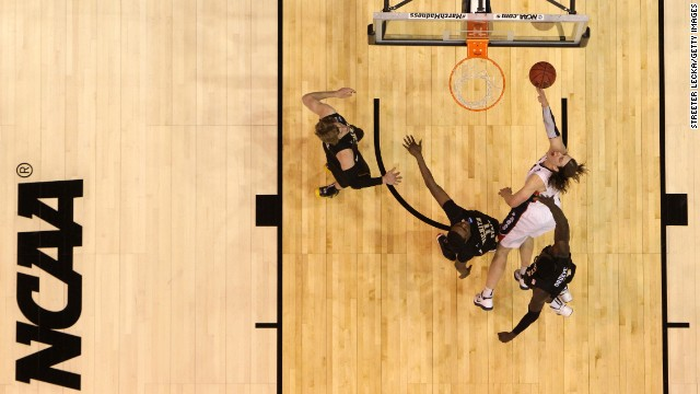 Kelly Olynyk of Gonzaga goes up for a shot against Cleanthony Early, second from left, and Ehimen Orukpe, right, of Wichita State on March 23.
