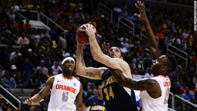 Rakeem Christmas of Syracuse, right, defends against Robert Thurman, center, of California on March 23.