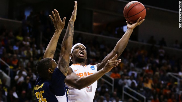 C.J. Fair of Syracuse, right, goes up against Richard Solomon, left, of California on March 23.