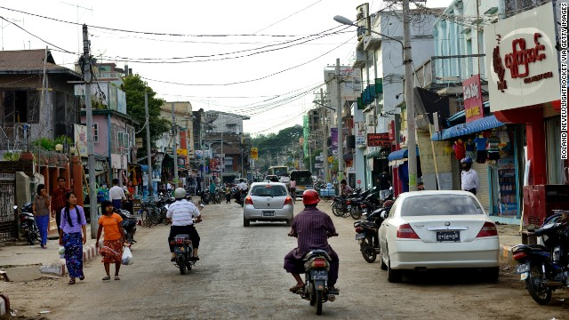 Scooters zip down the road in Pyinmana, a logging town and sugar refinery center near the new capital, Naypyidaw. The capital moved from Yangon to Naypyidaw in 2005.